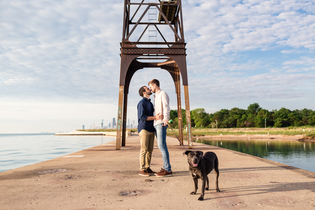 Montrose Harbor engagement photo with puppy on Lake Michigan pier
