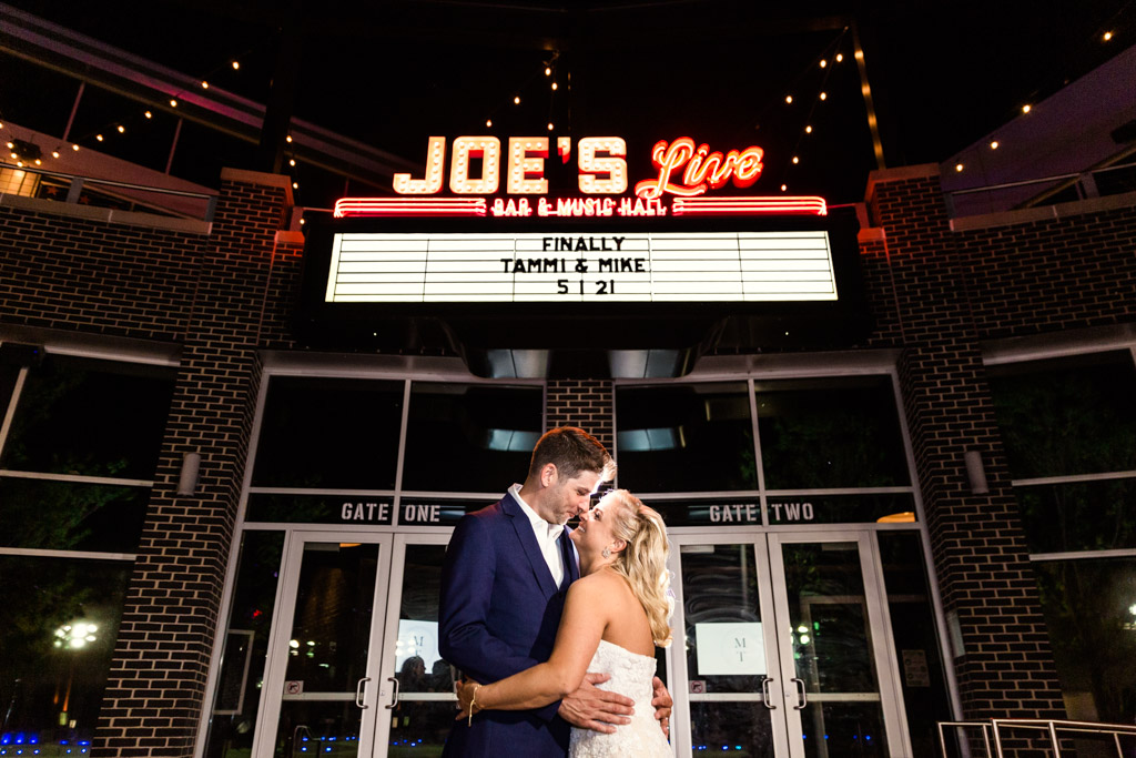 Epic night photo of bride and groom with their custom marquee at Joe's Live Rosemont wedding
