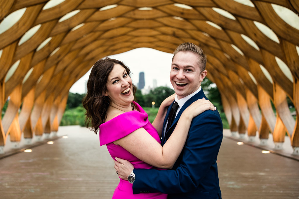 Candid summer Chicago engagement photo in Lincoln Park with honeycomb structure