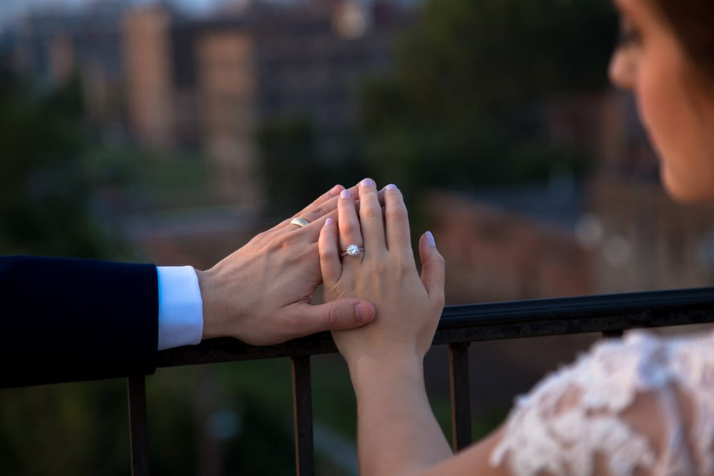 bride and groom show off their wedding rings